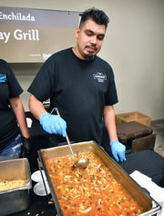 Chano Castro with Parkway Grill stirs a big batch of Chicken Enchilada soup Tuesday during the Empty Bowls event at the Wichita Falls Museum of Art.