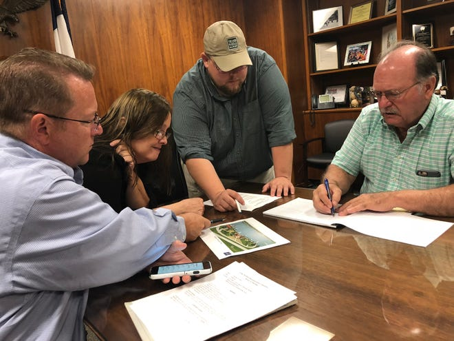 From left, Jim Dockery, Penny Miller, Tom Lang and Murphy Davis discuss placement of a fish-cleaning station near the Kemp Street boat ramp during a Lake Wichita Revitalization Committee meeting Tuesday morning. The station, made possible by a grant from Arconic, is expected be completed in November.