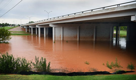 The Wichita River is several feet above its normal levels but not as high as during the May 2015 drought-ending flood as seen by the stain left on the I-44 overpass.