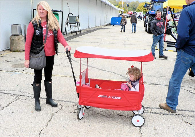 A little girl in her Radio Flyer wagon is ready for sun or rain.