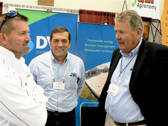Steve Dvorak, of DVO, Inc, Chilton, tells John C. Oncken (left), Grand Forks North Dakota and Bill Rowell,  Vermont dairyman about his 10,000 cow manure digester near completion in Australia.