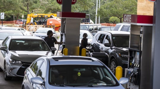 Drivers line up for gasoline as Hurricane Michael bears down on the northern Gulf Coast of Florida on Oct. 8, 2018, in Tallahassee, Fla.