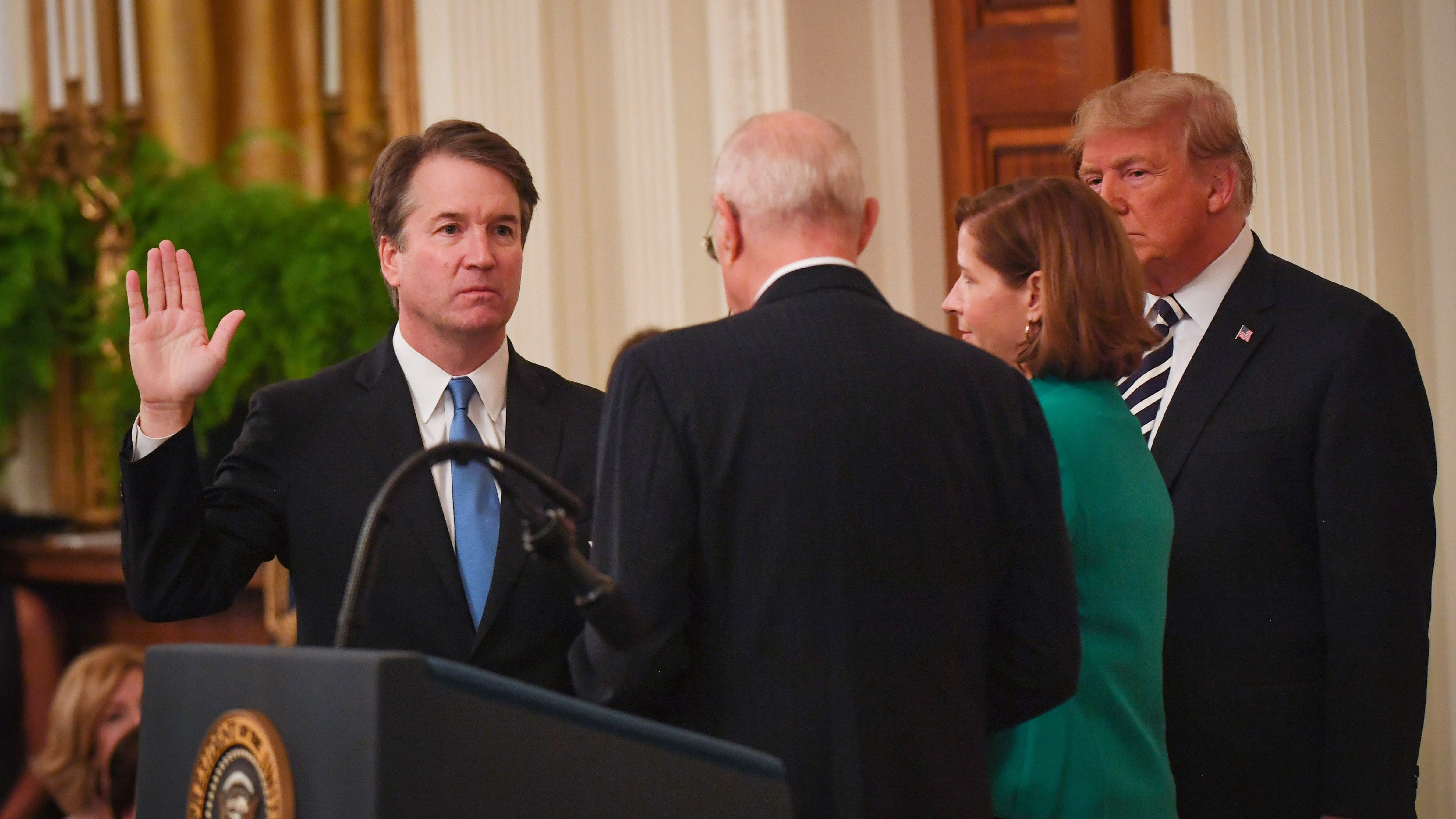 Newly confirmed Supreme Court Justice Brett Kavanaugh is sworn-in by retired Supreme Court Justice Anthony Kennedy.