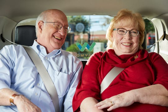 Barbara Adams, right, along with her husband Jim, has been using Waymo's self-driving cars to run errands and likes that she doesn't have to pay attention to the road during the trips.