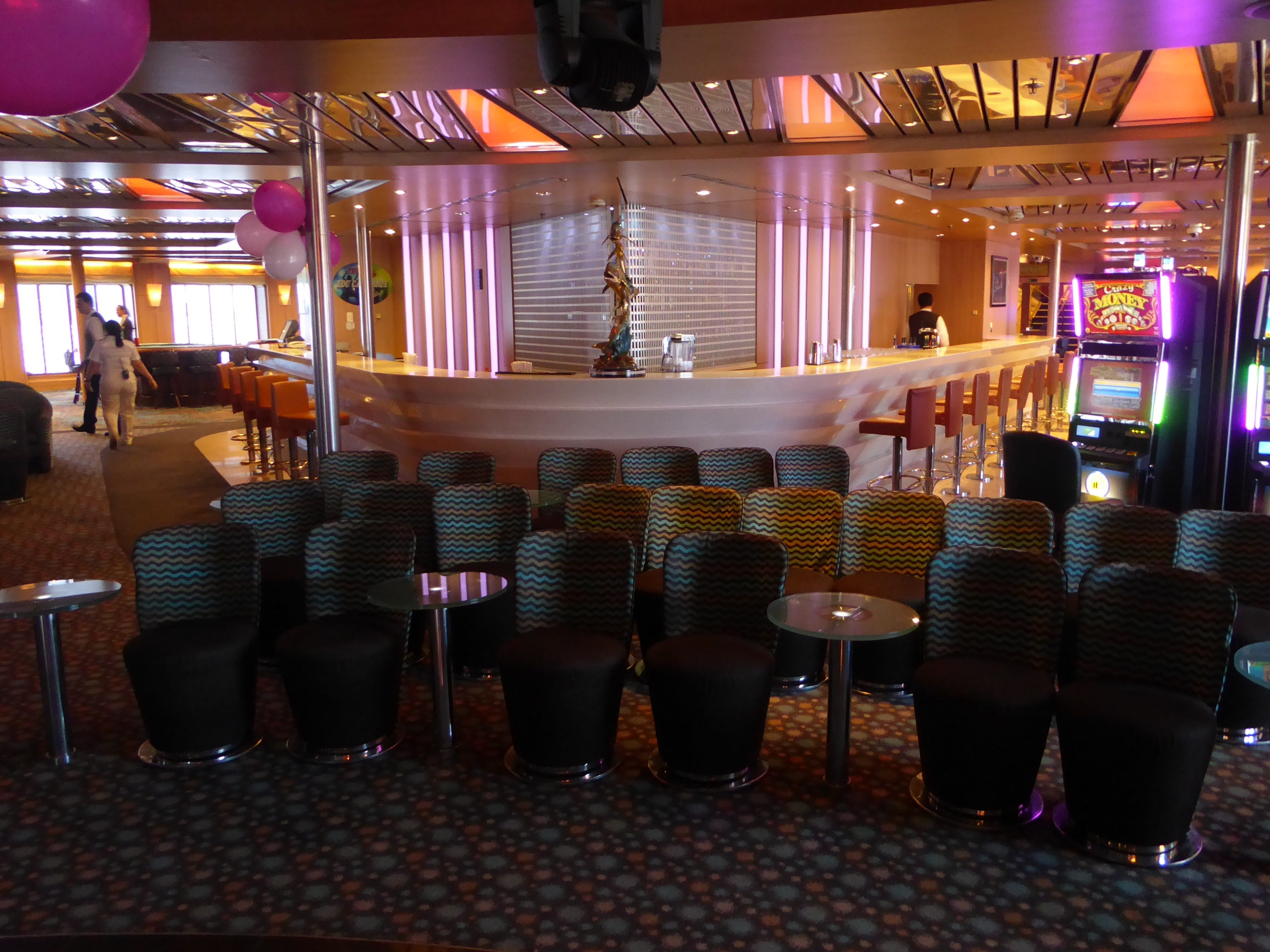 A V-shaped bar serves both the Encore Lounge and the Par-A-Dice Casino.