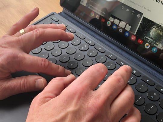 Typing on Google's Pixel Slate keyboard.