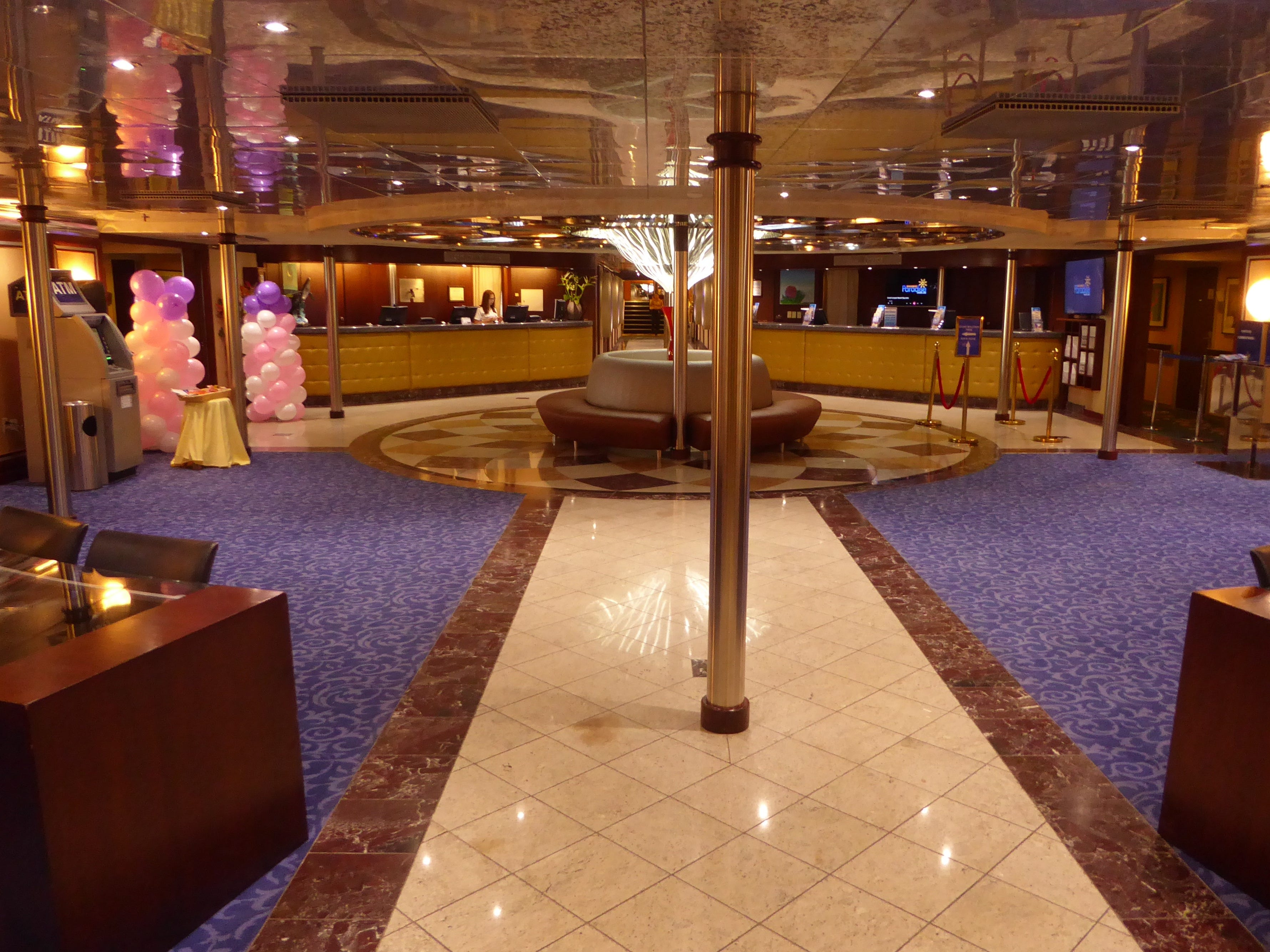 Most guests enter the Grand Celebration via the lobby on Moon Deck (5) where the reception desk is located.