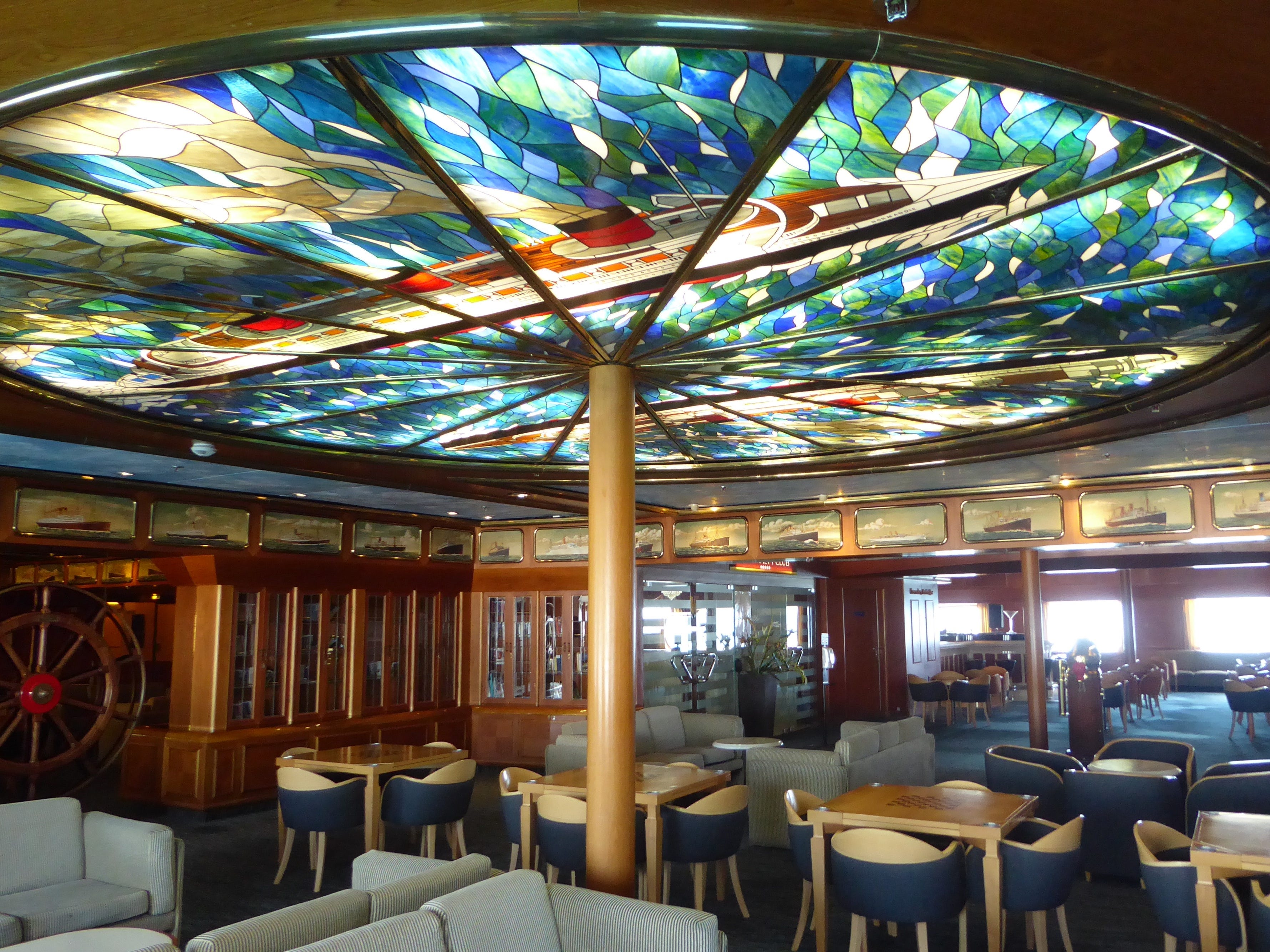 The Helm's decorative centerpiece is a stained glass ceiling designed by Carnival architect Joseph Farcus depicting the original Queen Mary and its rival, French Line's Normandie.