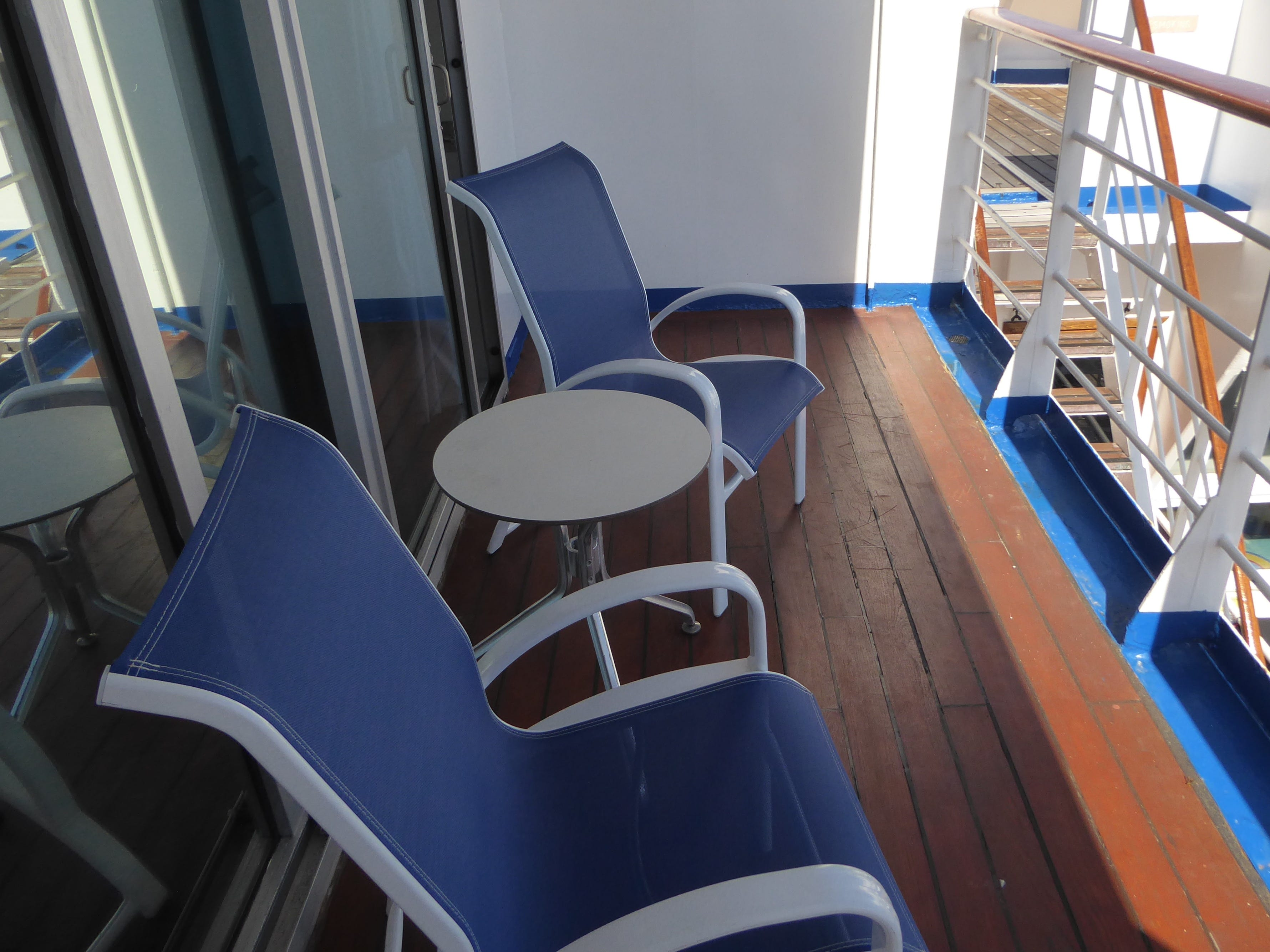 Deluxe Terrace Suite balconies are lined in teak and have space for a pair of chairs and a small table.