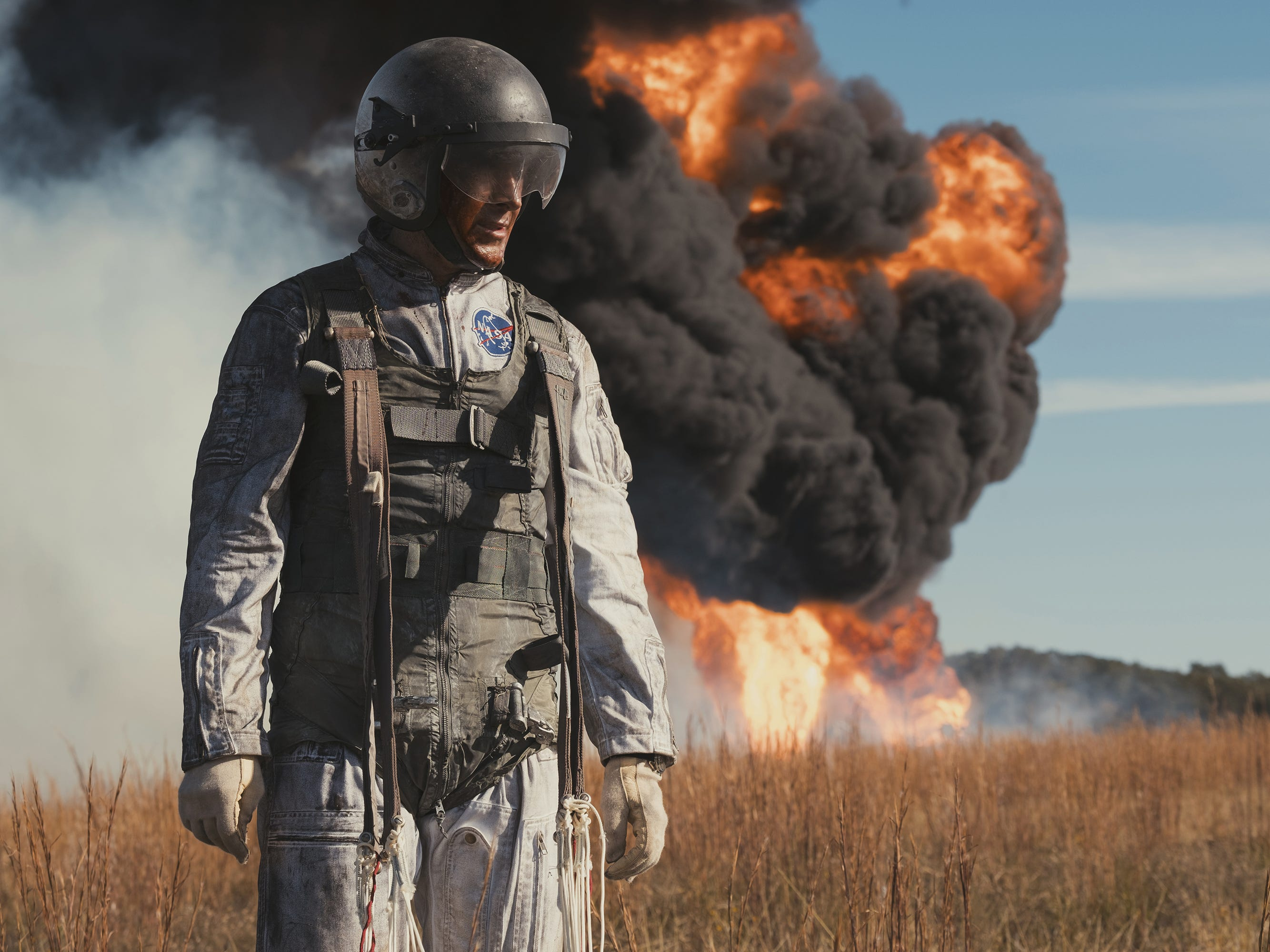 """Neil Armstrong (Ryan Gosling) narrowly escapes his lunar training vehicle before it crashes and burns in """"First Man."""""""