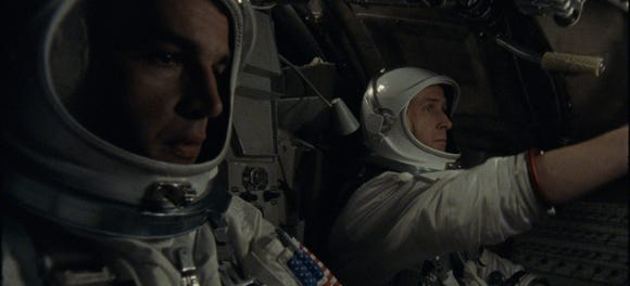 "David Scott (Christopher Abbott, left) and Neil Armstrong (Ryan Gosling) pilot the Gemini 8 mission before things go wrong in ""First Man."""