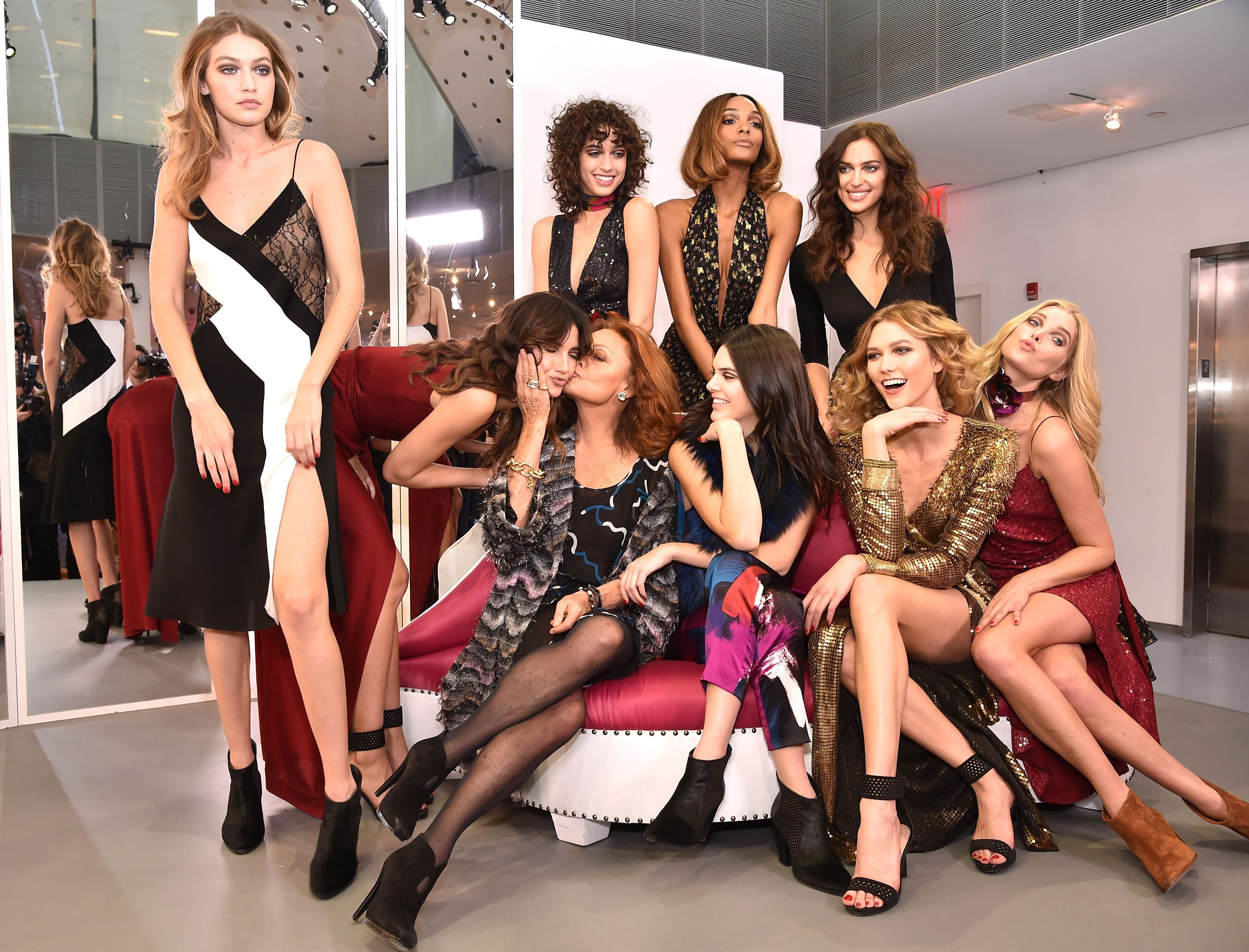 (Back row, left to right) Gigi Hadid, Lily Aldridge, Alanna Arrington, Jourdan Dunn, Irina Shayk, (front row, left to right) Diane Von Furstenberg, Kendall Jenner, Karlie Kloss and Elsa Hosk pose wearing Diane Von Furstenberg Fall 2016 fashion wear during New York Fashion Week on Feb. 14, 2016, in New York City.