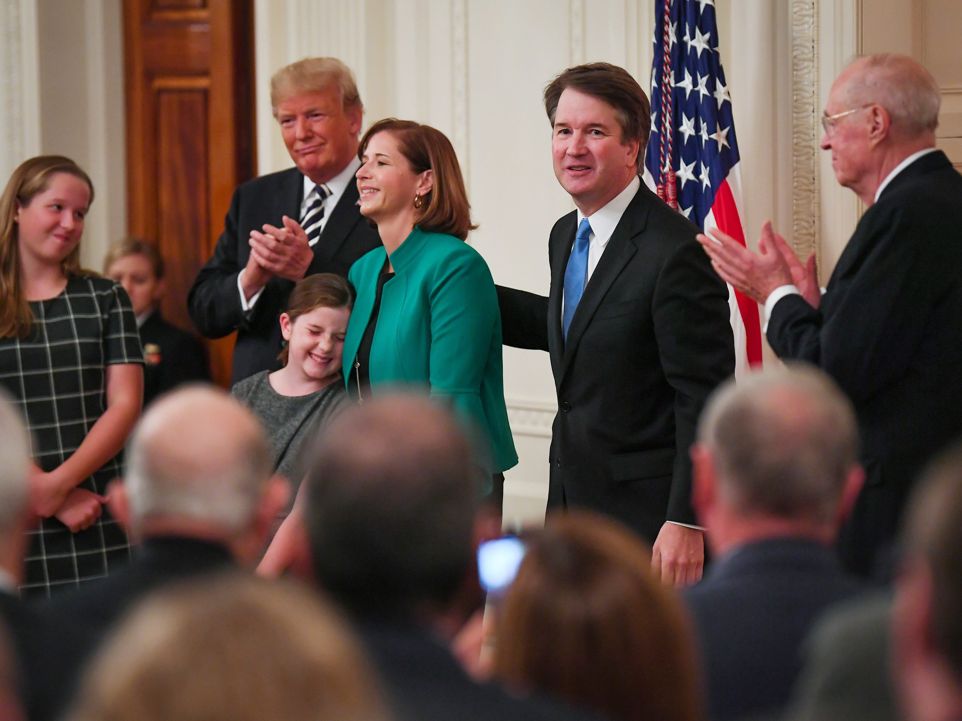 Justice Brett Kavanaugh, his family, President Donald Trump and retired Supreme Court Justice Anthony Kennedy during the ceremony in the East Room of the White House.