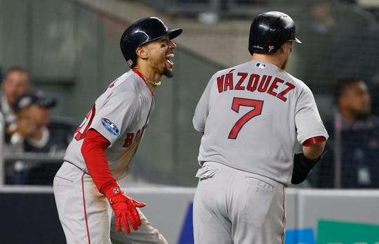ALDS Game 3: Red Sox right fielder Mookie Betts and catcher Christian Vazquez score two of the seven runs in the fourth inning.