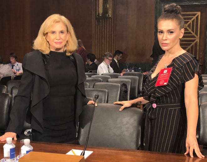 Milano poses with Rep. Carolyn Maloney (D-N.Y.) on Sept. 27, ahead of the confirmation hearing for Supreme Court Justice Brett Kavanaugh.