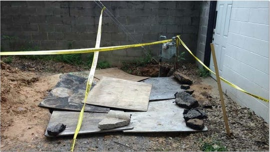 An exhibit filed in the Williams family's lawsuit against Centerpoint Energy shows crews covered up a gas line repair with plywood and chunks of asphalt.