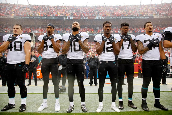 Fewer NFL players are protesting during the national anthem, as the focus has shifted to the work they are doing off the field to help local communities.