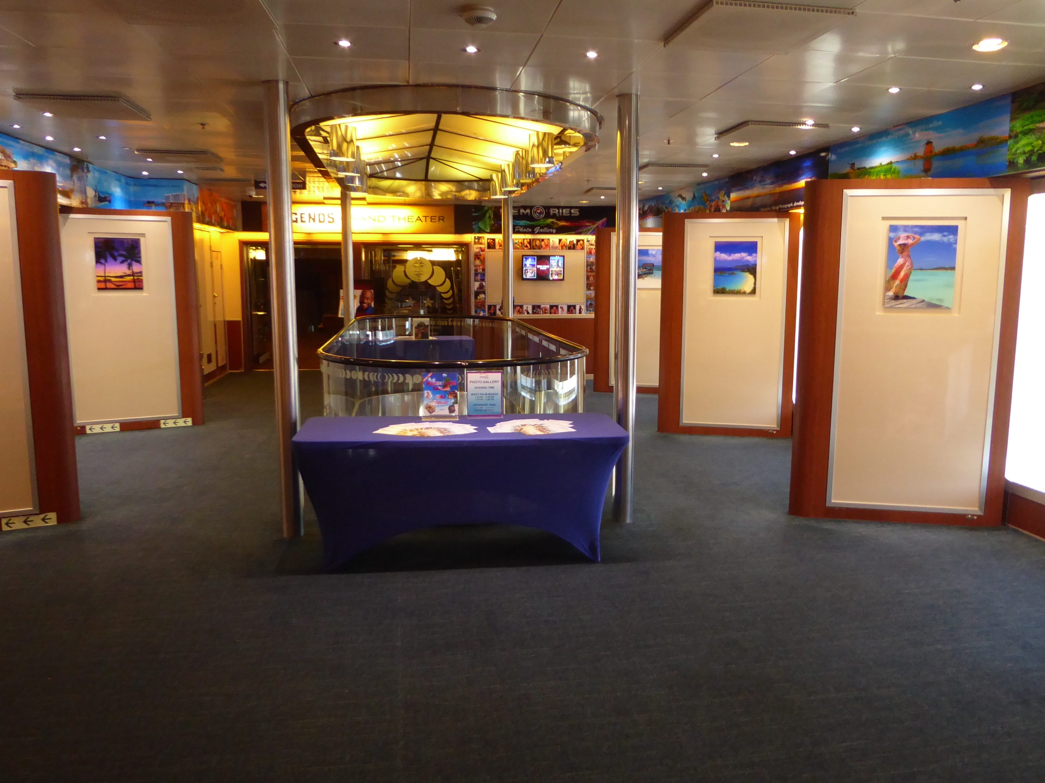 The Memories Photo Gallery is located at the starboard entrance to Legends on Paradise Deck.
