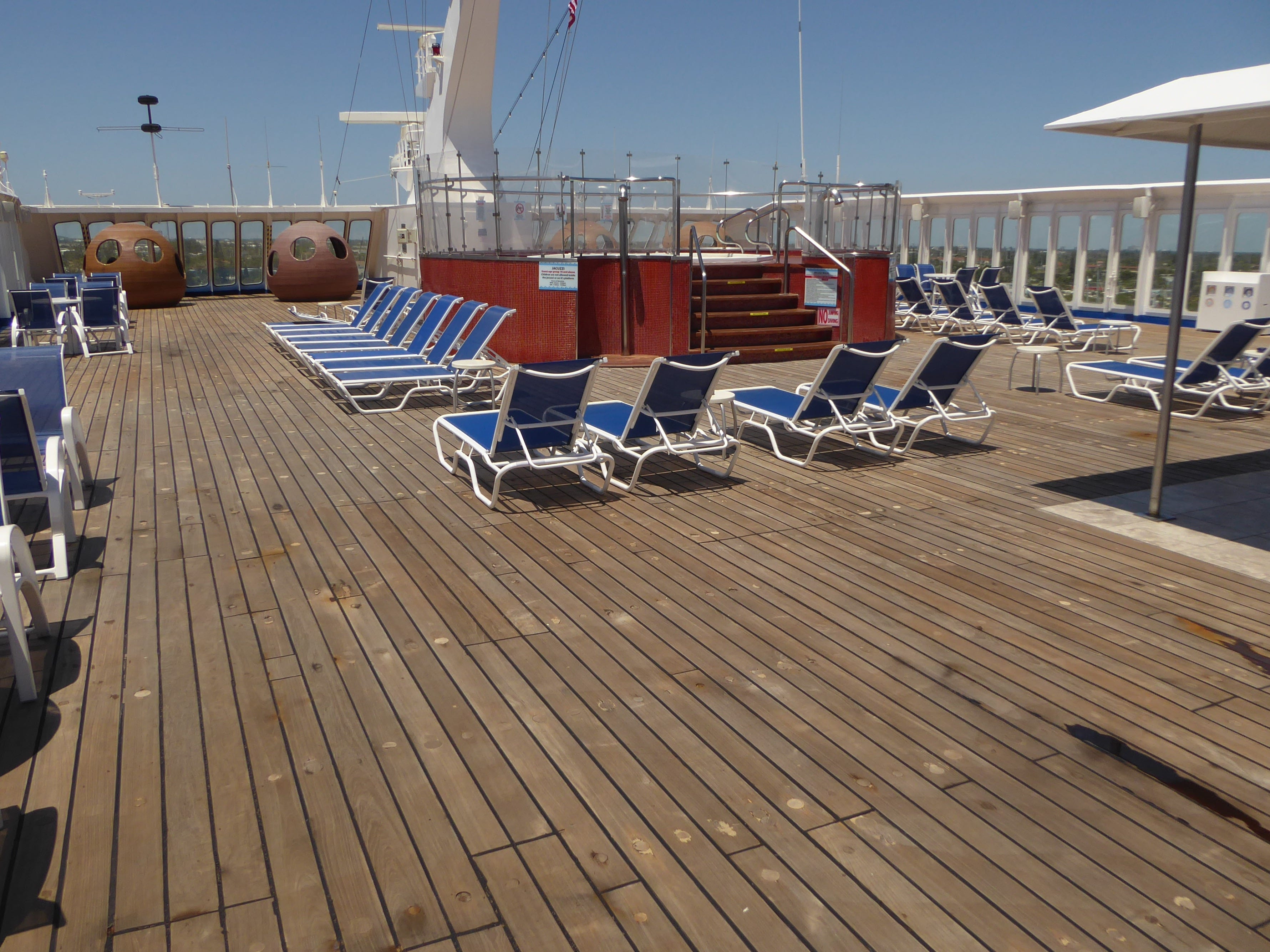 The Grand Celebration has nine guest decks, beginning at the top with Sun Deck (12). Sun Deck is lined in teak and sheltered from high winds on three sides by glass panels.