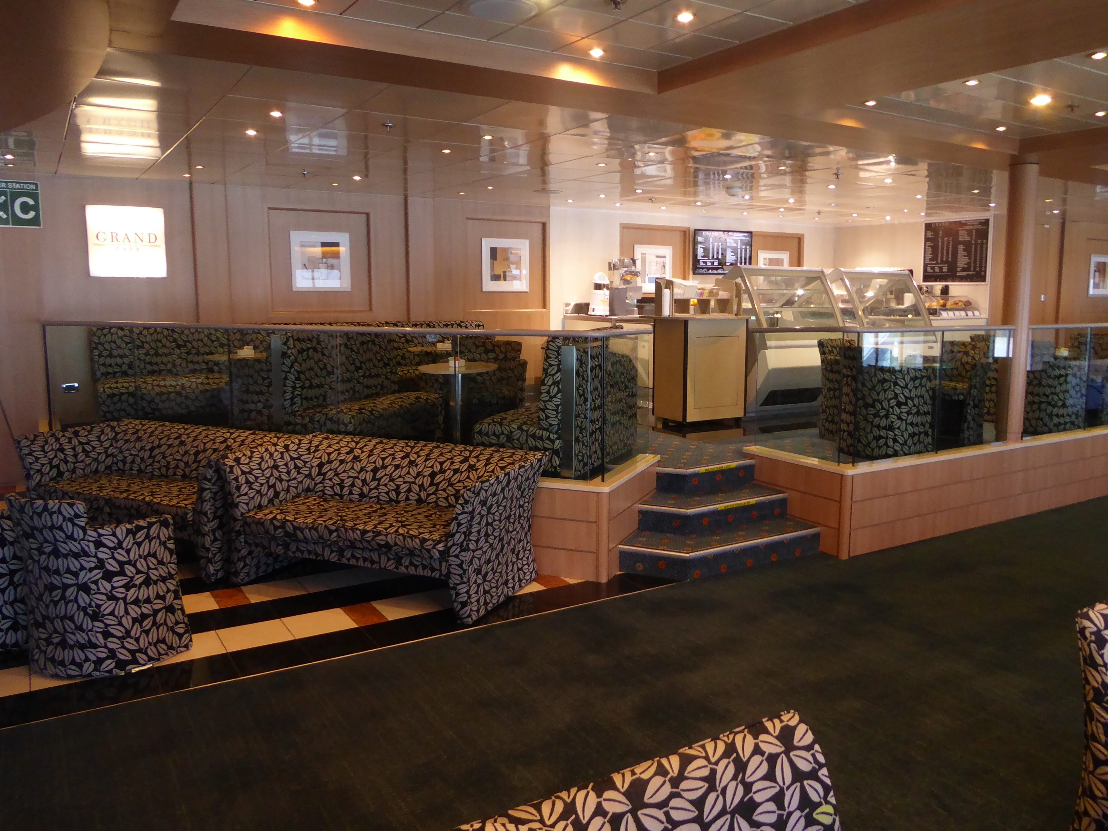 The Grand Cafe is a specialty coffee shop on the starboard side of Paradise Deck.
