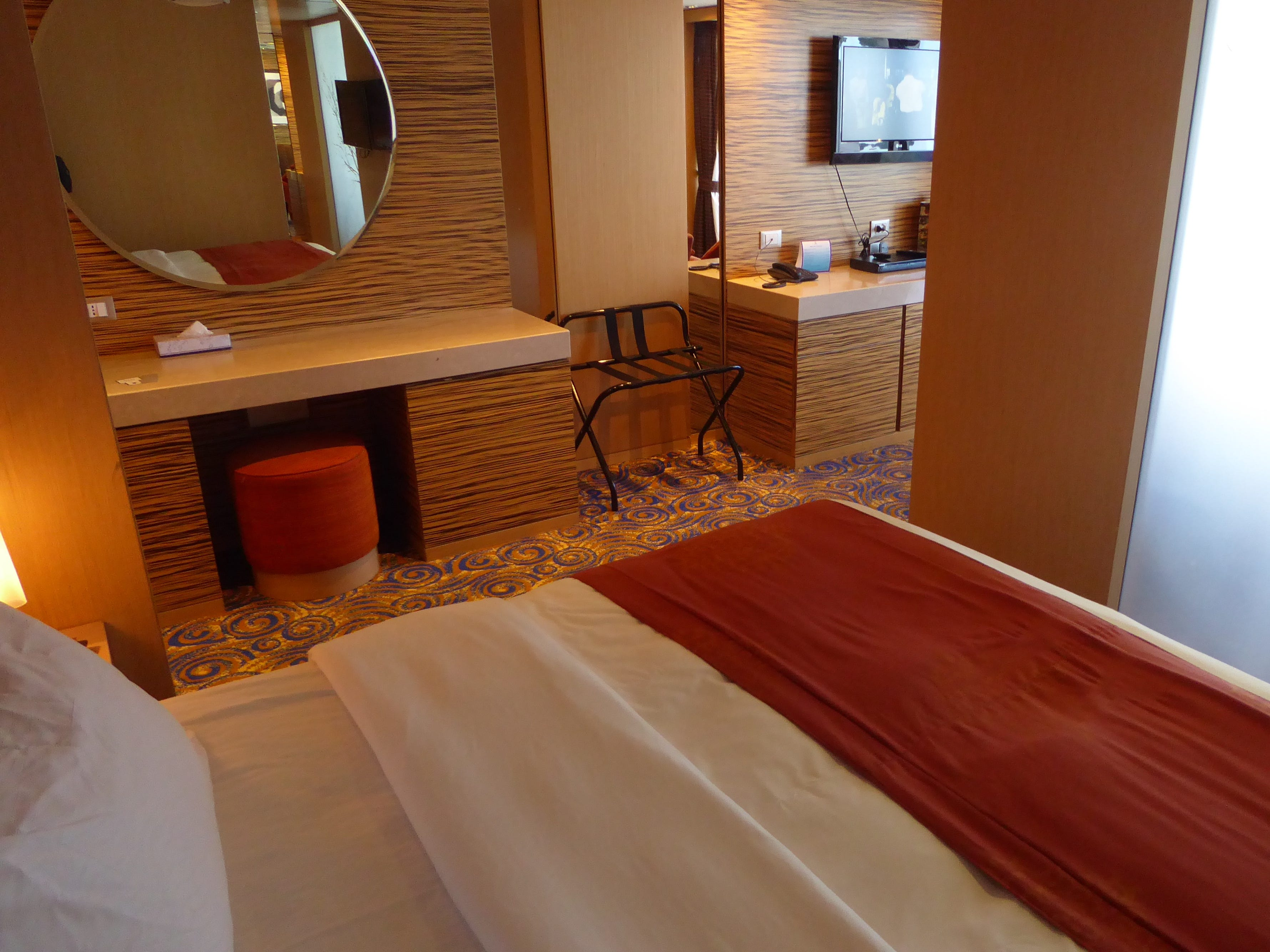 Deluxe Terrace Suite bedrooms have an oversized mirror and a dressing area.