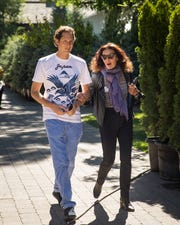 Left to right, John Elkann, chairman of Fiat Chrysler Automobiles, walks with fashion designer Diane von Furstenberg at the annual Allen & Company Sun Valley Conference on July 12, 2018, in Sun Valley, Idaho. Every July, some of the world's most wealthy and powerful business people from the media, finance, technology and political spheres converge at the Sun Valley Resort for the exclusive weeklong conference.