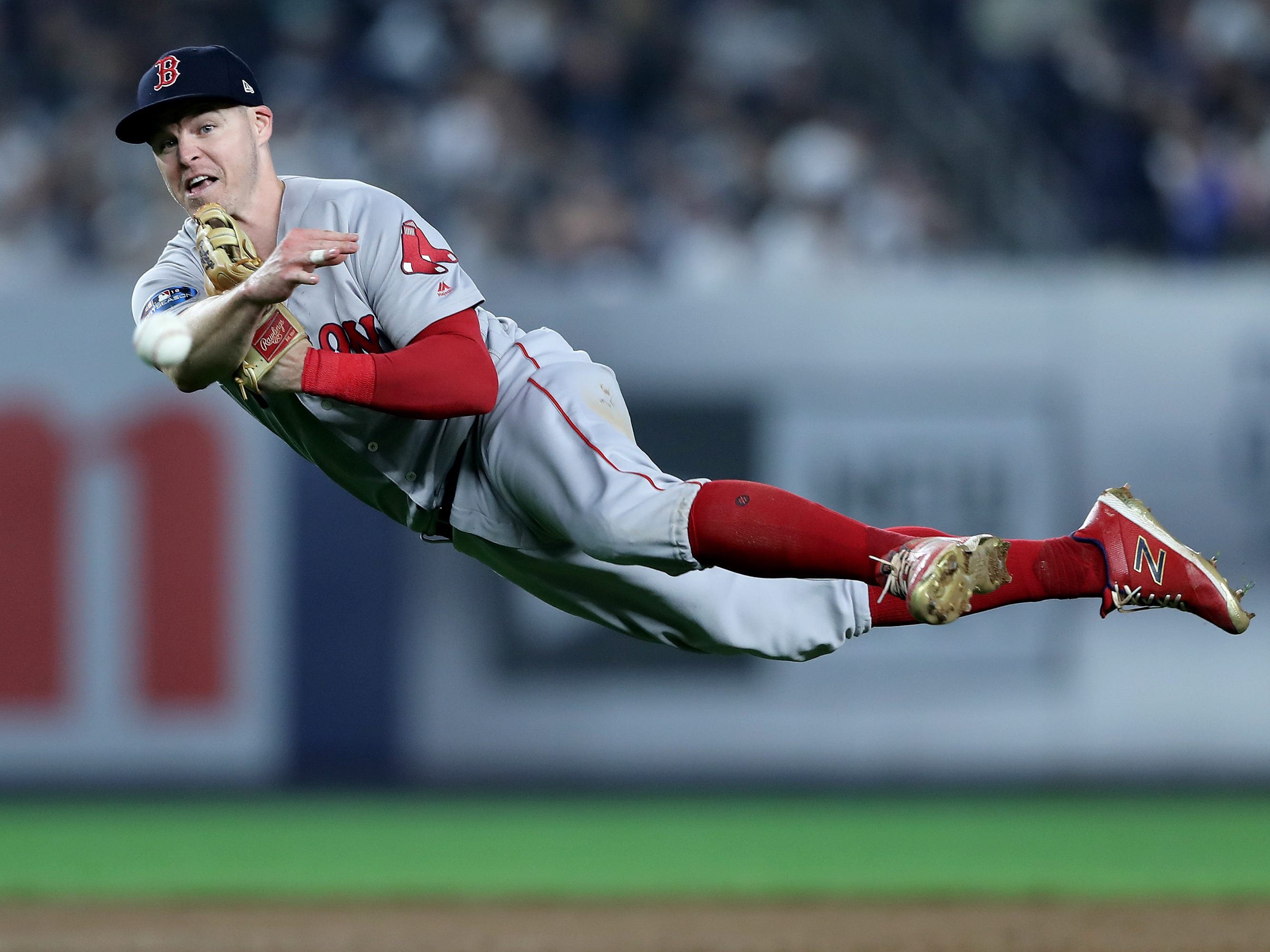 ALDS Game 3: Red Sox second baseman Brock Holt fields a hit by Luke Voit.