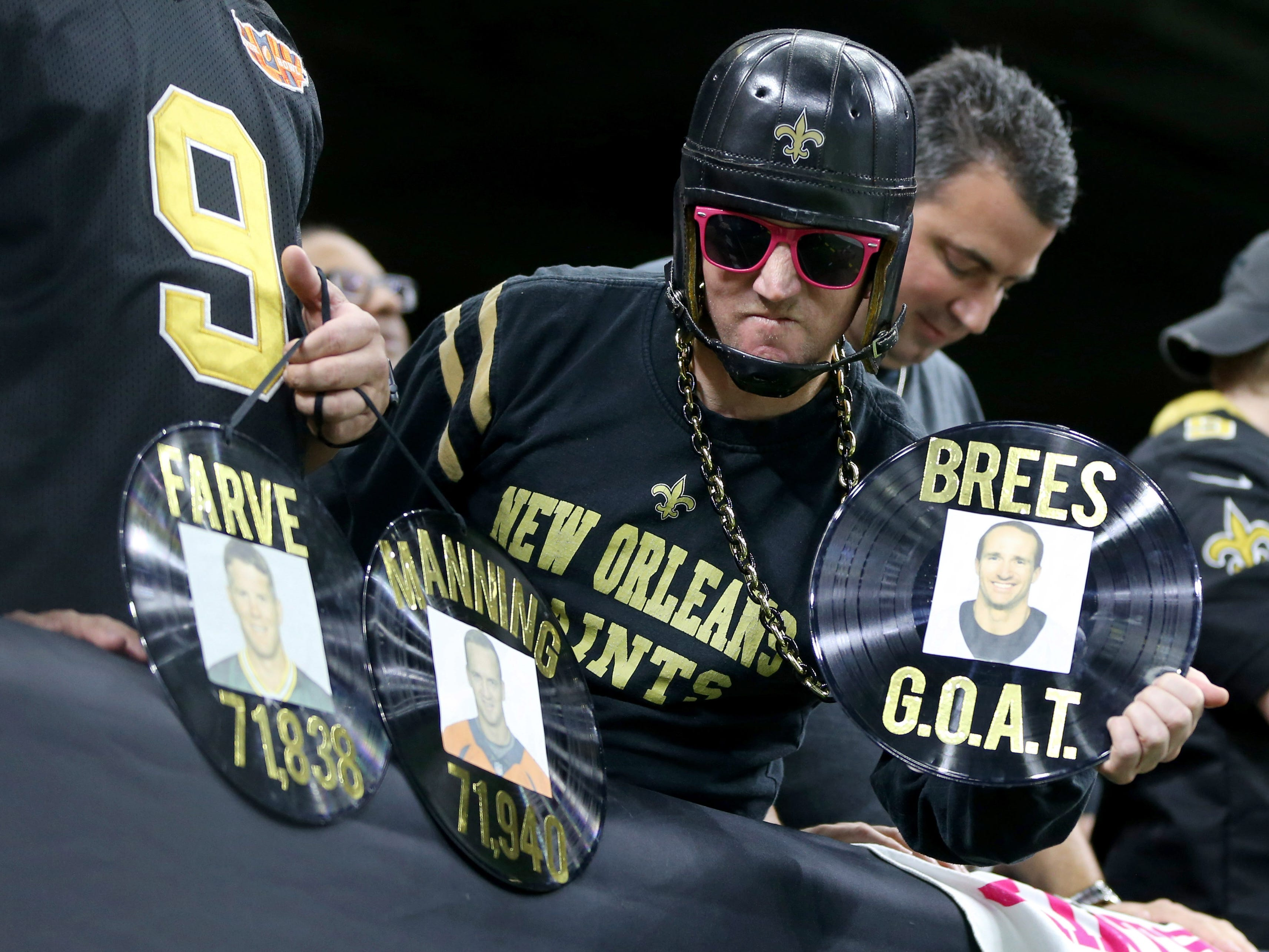 New Orleans Saints fans prepare to celebrate quarterback Drew Brees' NFL record for career passing yards, set against the Washington Redskins at the Mercedes-Benz Superdome.