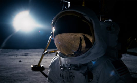 "Neil Armstrong (Ryan Gosling) looks at the lunar landscape in ""First Man""."