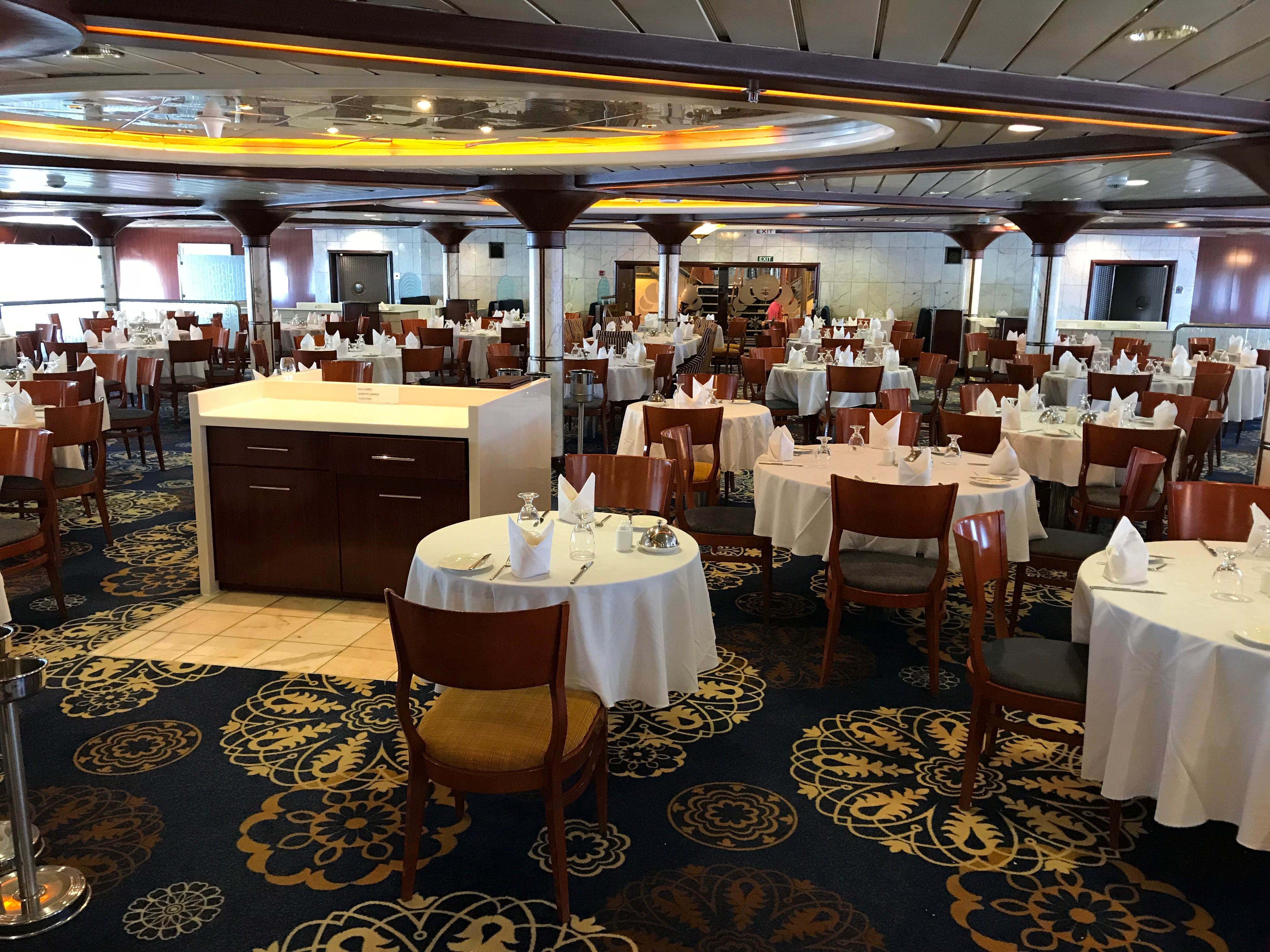 The Admiral's Steak and Seafood is an open-seating, extra-tariff ($30 cover) surf and turf restaurant on Aries Deck. This is the elevated mid-section of the room.