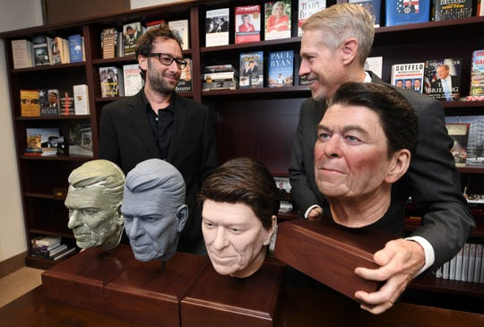 John Heubusch, executive director of the Ronald Reagan Foundation and Institute, right, and Davis Nussbaum, senior vice president of Hologram USA, with models of President Ronald Reagan that were used in the creation of a new hologram presentation.