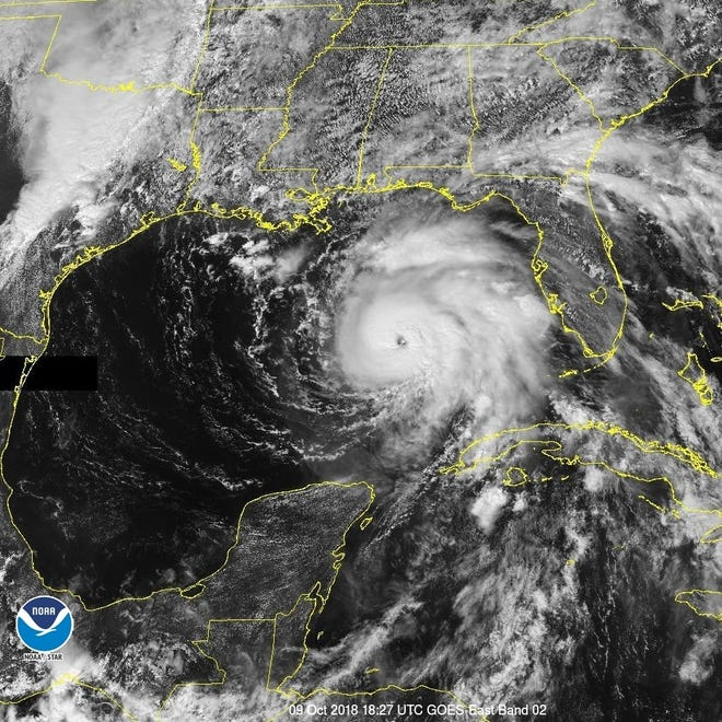 A satellite image taken Tuesday afternoon, October 9, 2018, shows Hurricane Michael spinning in the eastern Gulf of Mexico.