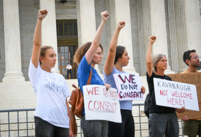 Protesters assembled in front of the Supreme Court on Tuesday, Justice Brett Kavanaugh's first day on the job.