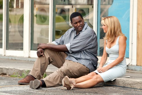 "Football prodigy Michael Oher (Quinton Aaron) is adopted by Leigh Anne Tuohy (Sanda Bullock) in ""The Blind Side."""
