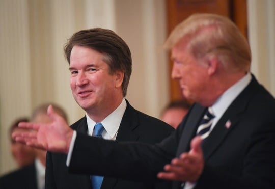 President Trump welcomes newly confirmed Supreme Court Justice Brett Kavanaugh to the East Room of the White House.