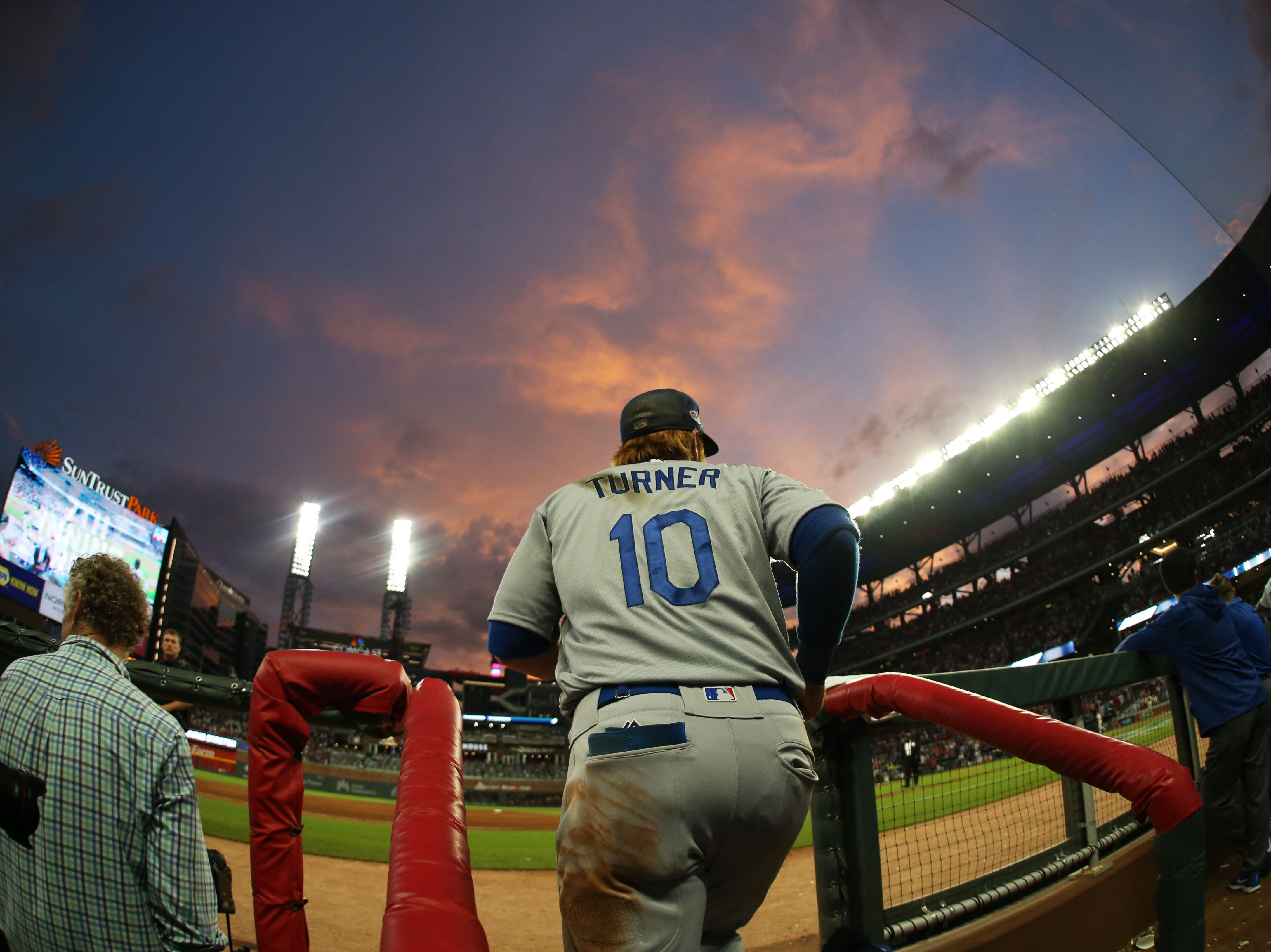 NLDS Game 4: Dodgers third baseman Justin Turner makes his way out of the dugout.