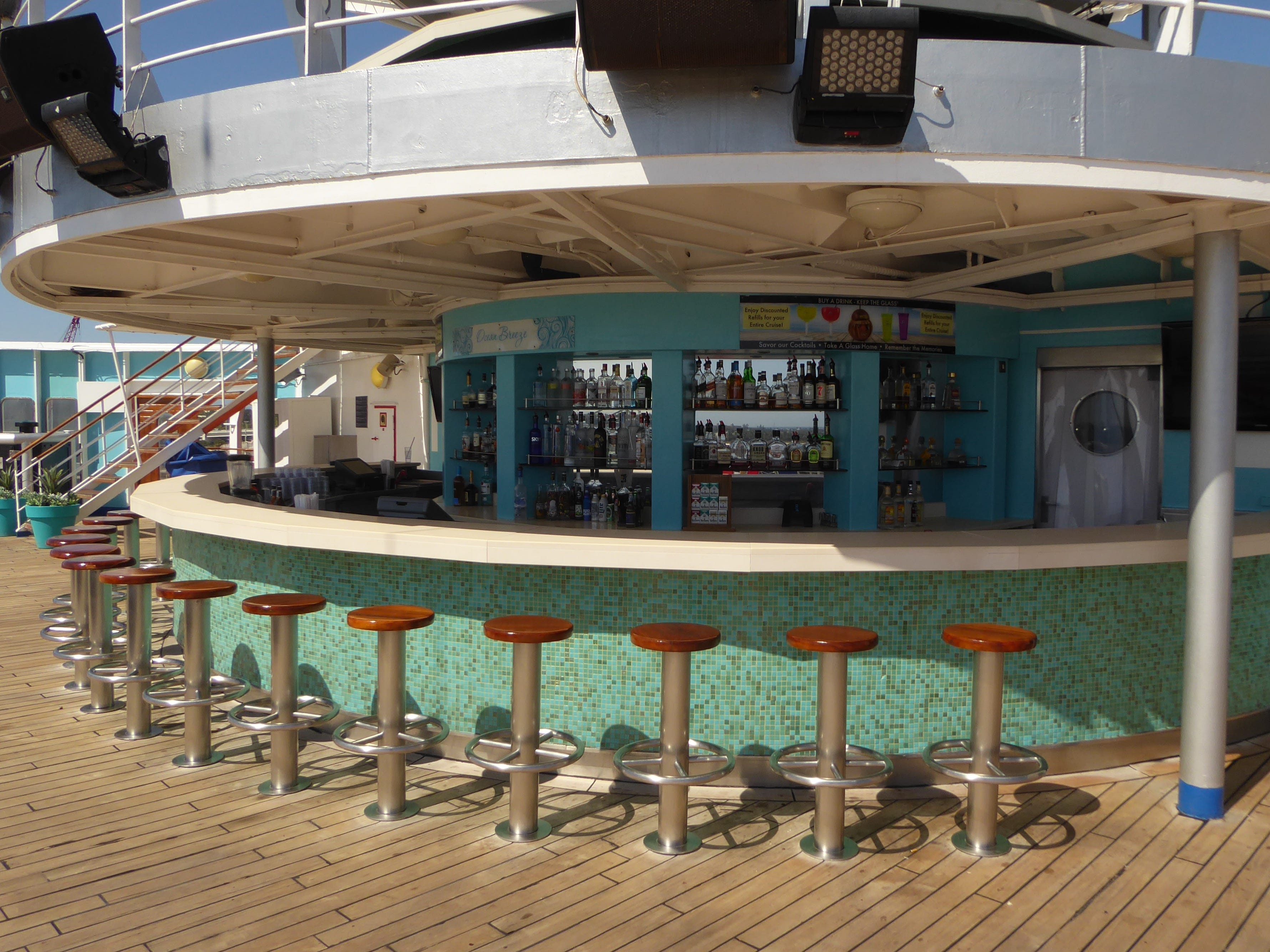 Named for a classic former ocean liner that used to sail between Florida and the Bahamas, the Ocean Breeze Bar serves the aft portion of Luna Deck.