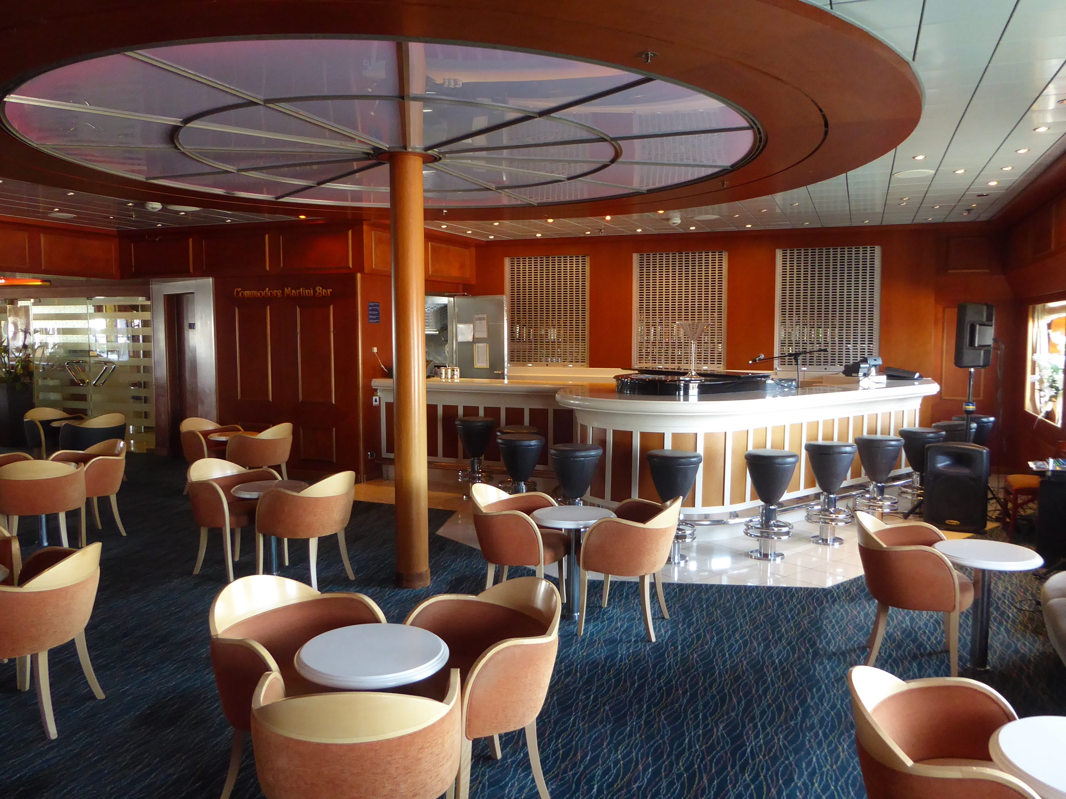 The Commodore Bar is a popular pre- and post-dinner watering hole on port Aries Deck.