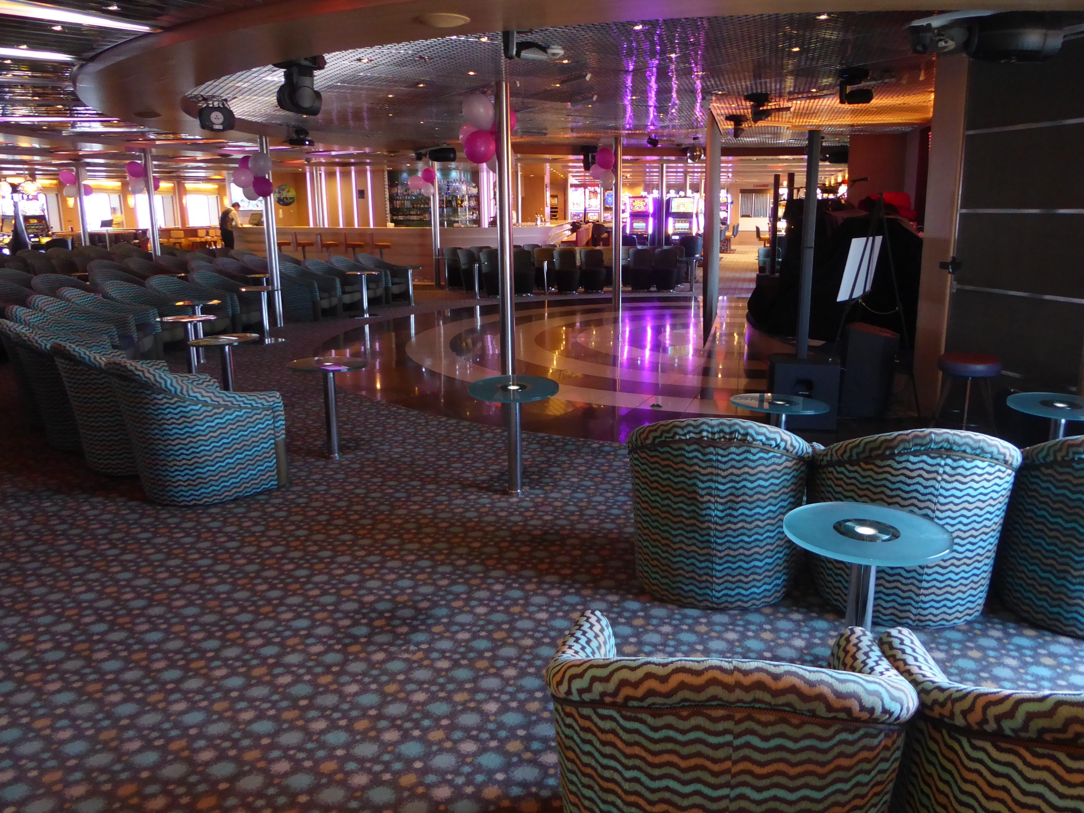 The Encore Lounge has an open floor plan with its own bar and a small stage.