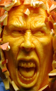 Ray Villafane's elaborate pumpkin sculptures often have lifelike facial expressions. Sometimes he uses a mirror while sculpting to reference his own face.