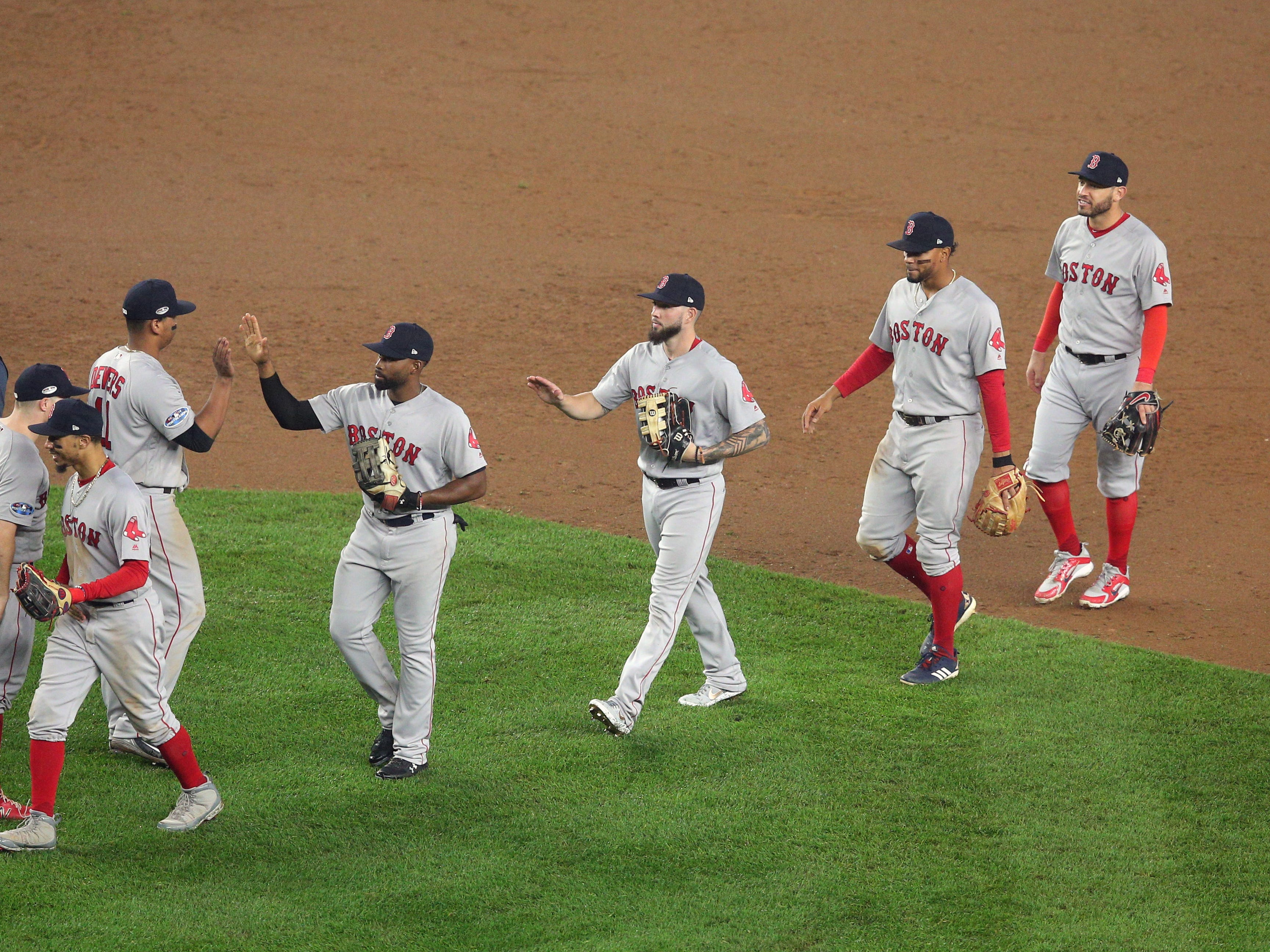 ALDS Game 3: The Red Sox celebrate after defeating the Yankees 16-1.