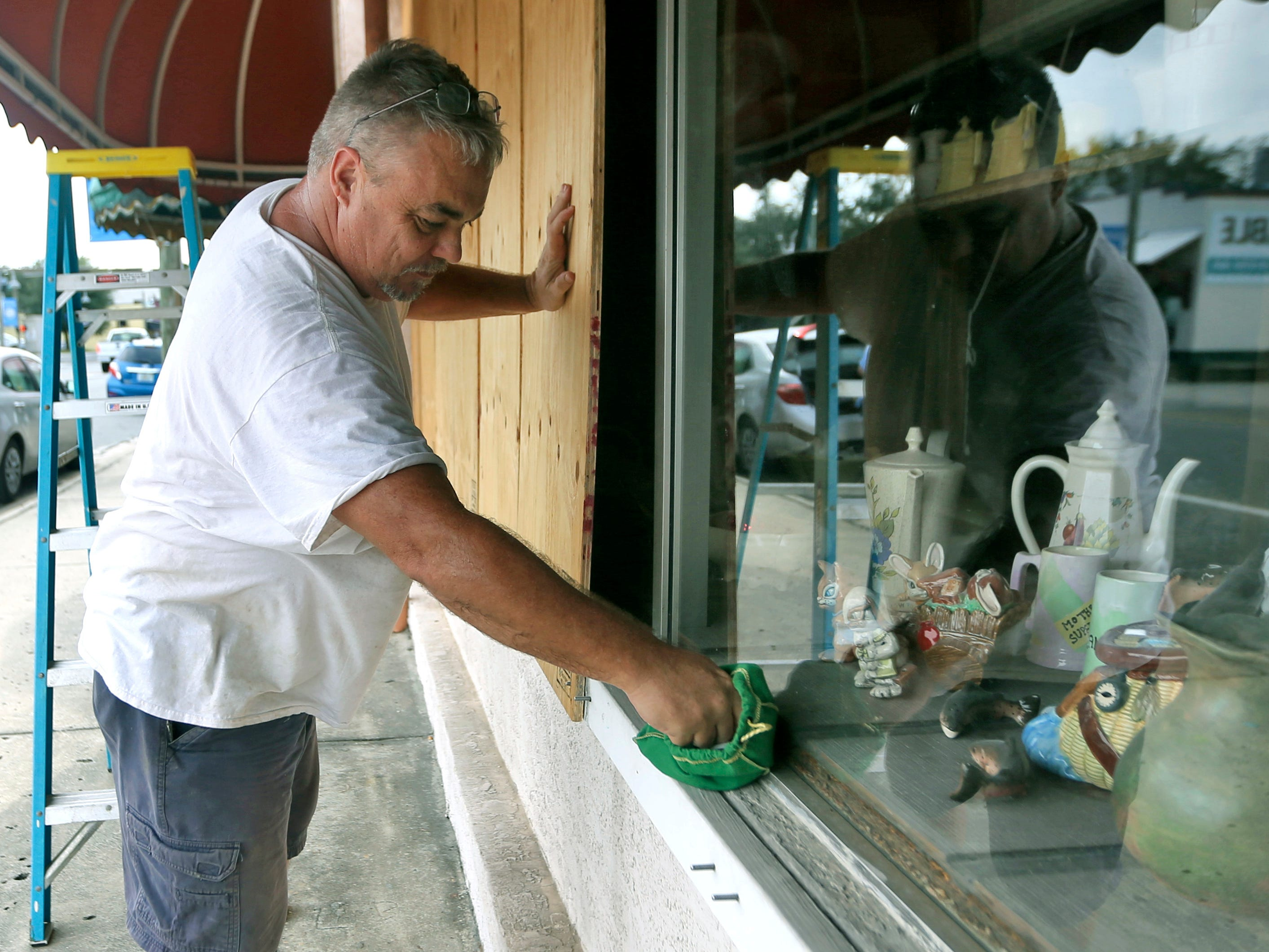 Bobby Smith boards up the windows at Jani's Ceramics in Panama City, Fla., on Oct. 8, 2018, in preparation for the arrival of Hurricane Michael.