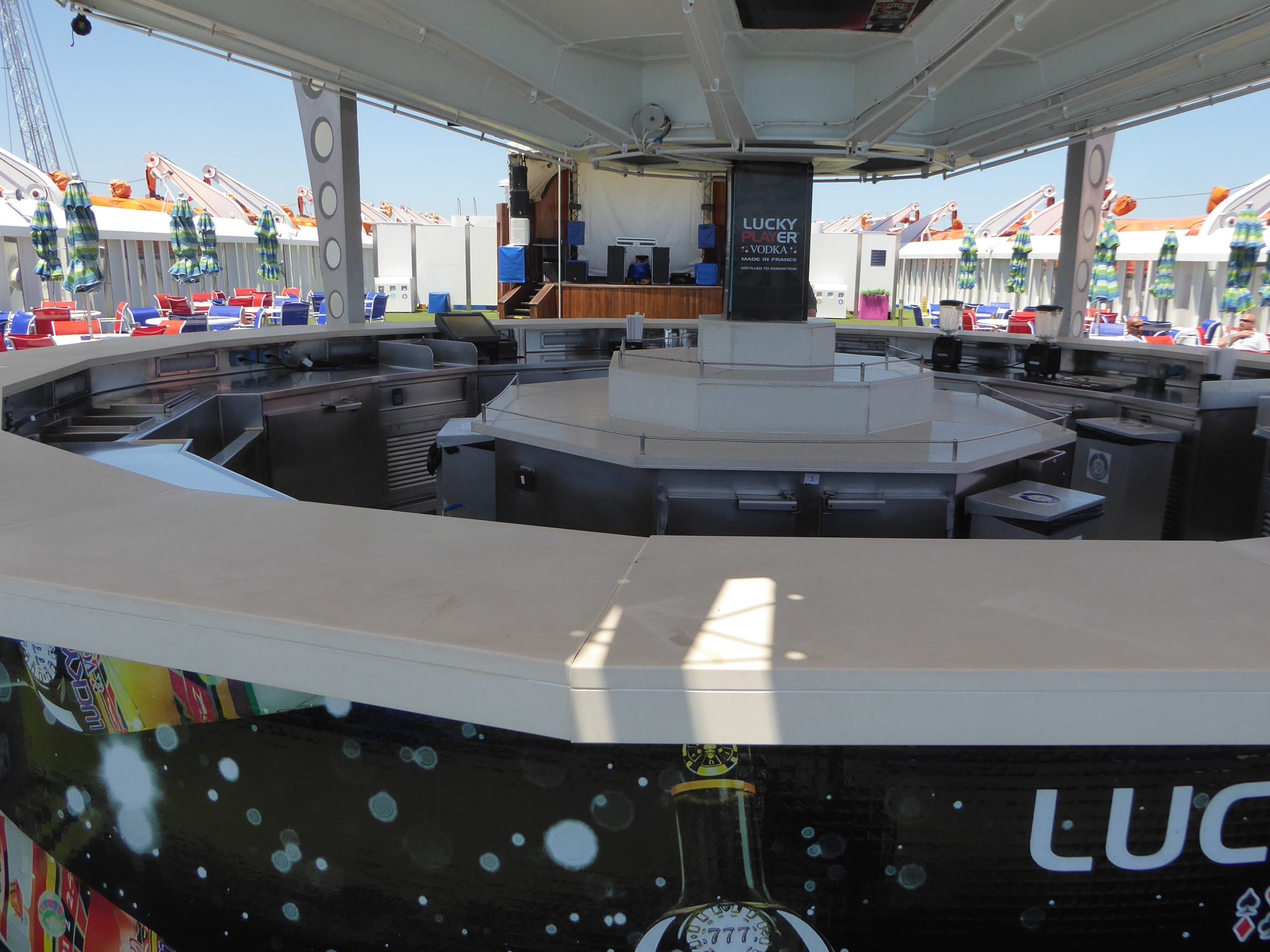 The al fresco Dancing Martian Bar is located at the far aft end of Venus Deck.
