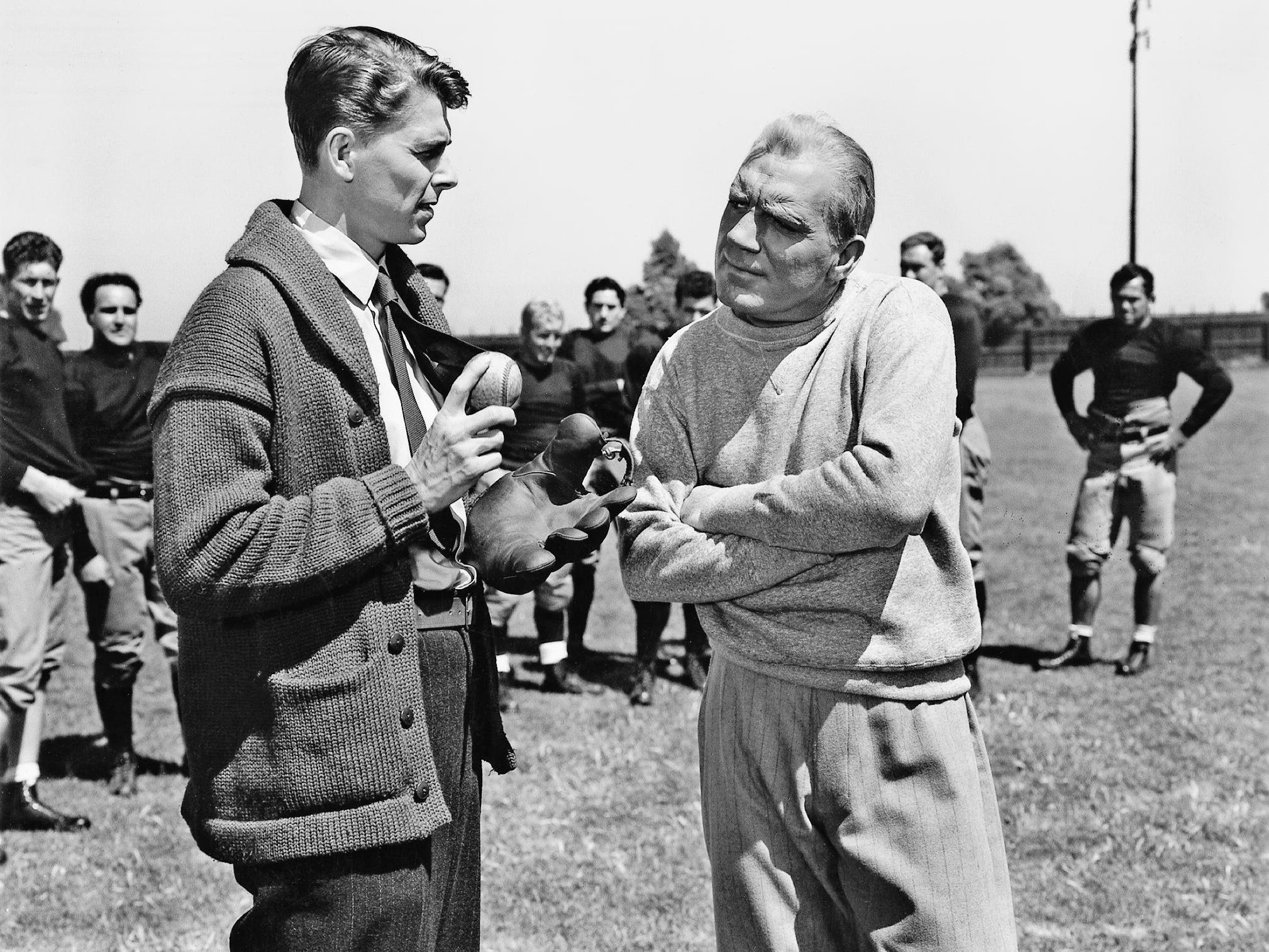 "George Gipp (Ronald Reagan, left) is the star halfback for Notre Dame coach Knute Rockne (Pat O'Brien) in 1940's ""Knute Rockne, All American."""