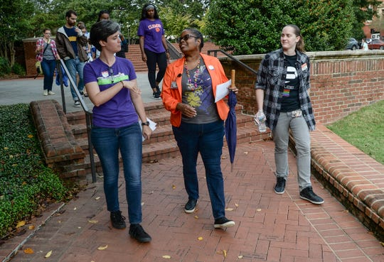 Ciera Durden, left, Associate Director of Clemson University Multicultural Community Development, leads and listens to Lisa Sims, middle, and Megan Lynch, right, during an ally walk around campus on Wednesday, Oct. 10.
