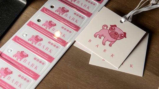 Product tags at Bark, a dog boutique store in downtown Anderson.