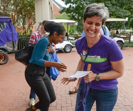 Ciera Durden, right, Associate Director of Clemson University Multicultural Community Development, shares a laugh with Sarah Dumas, left, joining the ally walk around campus on Wednesday, Oct. 10.