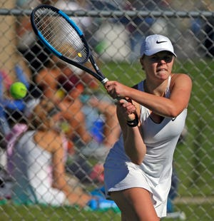 Erika Curtin of Xavier competes during the Bay Conference tennis conference tournament Sept. 22 in Appleton.