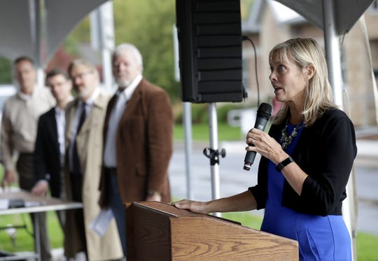 Mary Parsons, executive director at LEAVEN, speaks during the grand opening of the new LEAVEN Community Resource Center on Wednesday in Menasha.