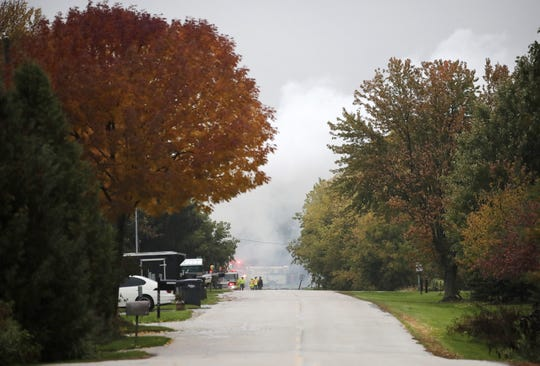 Smoke billows across Firelane 12 in Harrison after a house explosion.